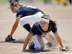 Aptos High senior Marissa Bugayong pulls herself from the dust after diving for a catch but missing during the CCS softball championships at the Salinas Sports Complex on Saturday. (Kevin Johnson/Sentinel)    From the CCS Spring Playoffs slide show: photos.santacruzsentinel.com/2013/05/12/photos-ccs-spring-playoffs-2013/#11