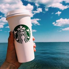 a hot Starbucks cup surrounded by the vast ocean seascape ~~