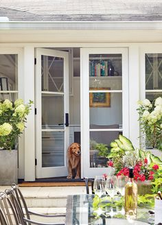 """The Patio Doors Open Up the Exterior - A Dramatic Ranch House Renovation - Southernliving. """"Ranches tend to have ceilings and not a lot of natural light, making them feel cramped,"""" Evans notes. Architecture Renovation, Front Door Makeover, Exterior Makeover, French Doors Patio, French Patio, Front French Doors, Farmhouse Patio Doors, French Farmhouse, Country Farmhouse"""