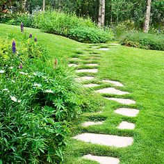 In Aspen, pavers of Colorado buff sandstone form a trail across this Kentucky bluegrass lawn to a grove of aspens. Set low enough for a mower to pass over them easily, the pavers were placed atop a base of compacted sand. Then the sod was planted around and between them.