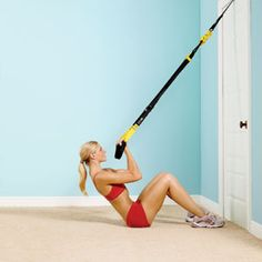 Mixing TRX with yoga is a great hybrid workout: The suspension both supports and challenges many yoga poses. #SelfMagazine
