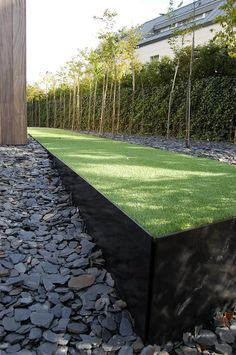 Raised lawn planter with contemporary minimalist edging