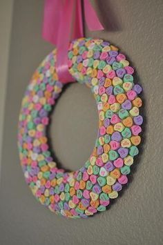 Foam ring, glue candy hearts on, attach ribbon and hang...might make a fun kids craft on a smaller scale.