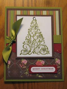 Lovely Handmade Christmas Tree Card...love the different striped and floral papers on this card and the bling on the tree...Melissa's Stampin Memories: Handmade Christmas Cards For Sale.  Picture only for inspiration.