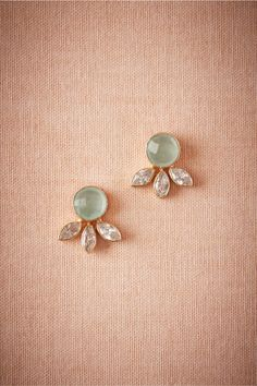 Fanned zircon leaves flank chalcedony buds on this gold-dipped brass pair.
