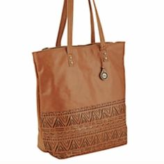 """The Sak Tobacco Tribal Perf Palisade Tote- New This tribal tote has great crafted details featured on the front of the Palisades Tote Made of soft leather, this tote is roomy enough to carry all your essentials, everywhere you go! 15.5"""" x 14"""" x 5"""", strap drop: 11.25"""" Exterior: leather Interior: polyester Antique silver tone hardware Magnetic closure Interior lining features two open multi-function pockets and a zippered back wall pocket. Brand new with tags! The Sak Bags Totes"""