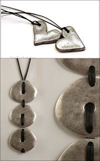 This is brilliant!  She made small pendants with salt dough and then sprayed them with Rustoleum in silver.  So cool!