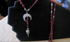 Red Beaded Rosary Featuring Silver Skulls and a by PirateKatsBooty