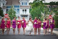 give your brides maids different shades of the same color, if you have a large number, then line them up based on the spectrum