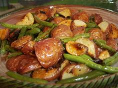 Roasted Potatoes and Green Beans from Food.com: This recipe is an adaption of a recipe found in Williams-Sonoma Essentials of Healthful Cooking. The roasting blends the flavors and produces a delightful side dish.