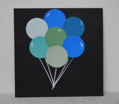 """Birthday card I made using paint chips from Home Depot cut with a 1"""" hole punch. The balloon strings are very fine strips cut from a sticker label. Cute & easy! : )"""