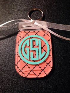 """Acrylic Mason Jar Decal 3"""" by 1.75"""" Key Chain with vinyl monogram, please message me your initials (First, Last, Middle), back ground choice, if you would like ribbon, and font if others is chosen. Lots of different options for the mason jar keychain, if you're looking for something more specific? Just send me a message. Don't forget to check out my Facebook page! ~Thanks Katie~ #MasonJar #CircleMonogram #KeyChain #KatieBuggaDesigns #VineMonogram"""