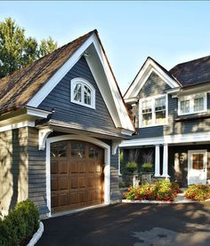 "Navy Exterior Paint Color: ""Benjamin Moore's Evening Dove DeGraw & DeHaan Architect. Paint the garage door"
