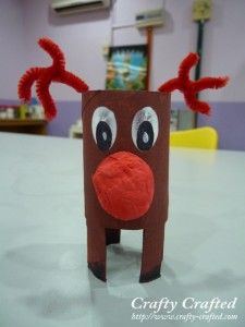 toilet paper roll reindeer- cut out the legs from the bottom of the roll, paint the reindeer brown and the feet black, - for eyes use white thumbprints, finally glue on nose and pipe cleaner antlers!  Stands on its own as a decoration or can be a cute ornament!!