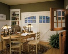 When converting a garage to livable space, there's always the issue of what to do with the garage door opening. Because this opening and the garage doors have such a large impact on the overall look of the house, it makes sense to fill the opening with a large-scale element. For example, a good solution is to keep a garage door in the opening while making sure the door is weather tight.