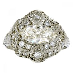 Art Deco Diamond Ring, MQ 0.92ct:: centering a Marquise cut diamond measuring approximately 9.95 x 4.95 x 2.76mm, weighing approximately 0.92ct (I-J color, VS2 clarity), flanked by twenty-two 1.35 to 2.0mm; bead set, round Single cut diamonds weighing approx 0.22ctw. Engraved and millegrain finishes, fashioned in platinum. Circa 1925. EGL313258801US. Size 6.5.