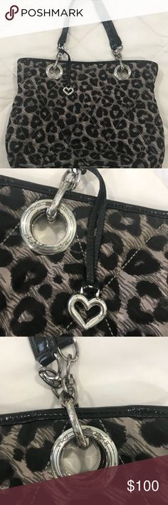 Brighton black and white animal print tote Brighton animal print tote bag. Inside is red with zipper pocket. Picture show where the silver has tarnished some. Purse is in excellent condition though. Very lightweight and roomy! Brighton Bags Totes