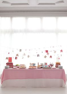 The buffet table with garlands hung above