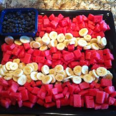 Another version of the 4th of July food flag. Cut up watermelon squares, bananas and bowl of blueberries for stars. Looks easier than others.