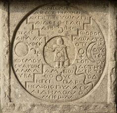 """A """"forgotten stone"""" carved by Carl Jung at his private sanctuary at Bollingen. It's full of carved astrological symbols"""