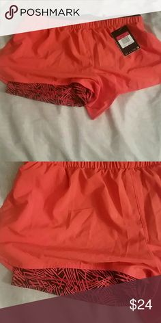 New Nike red & black shorts New Nike red & black shorts with patterned lining. Also has pockets. Size large Nike Shorts