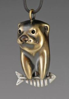 handcrafted river otter jewelry, river otter totems. If otter is Danny he caught his fishbonepirate.  :}