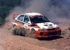 Mitsubishi Evo rally car kicking up dust. Subaru, Sport Cars, Race Cars, Richard Burns, Real Racing, Mitsubishi Motors, Off Road Racing, Mitsubishi Lancer Evolution, Roll Cage