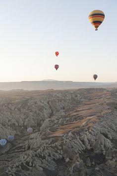 Hot air balloons over the Cappadocia Mountains in Turkey.