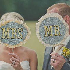 couple with mr and mrs signs