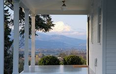 Gorgeous panoramic views of Mt. Adams and the Hood River Valley from the back porch of an old farmhouse that sits on seven acres in Oregon.