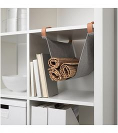 Made from real leather, this fabric hanging organizer gives a basic white storage unit a Scanavian touch.