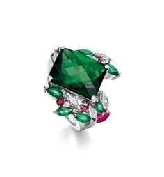 AN 8.49 CARAT GREEN TOURMALINE AND DIAMOND RING. Centring upon a rectangular-shaped green tourmaline, weighing 8.49 carats, flanked by vari-cut diamonds and vari-colour tourmalines, mounted in 18K gold.