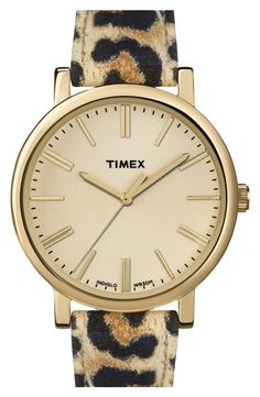 In love with this gold watch with a leopard leather strap that's totally chic!