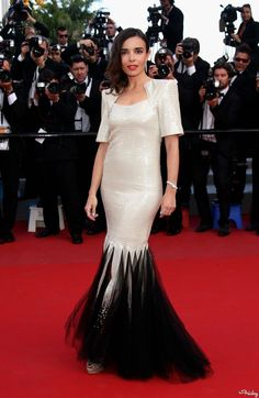 """Élodie Bouchez in a Fall 2011 dress with contrasting tulle hem and strong shoulders. """"On The Road"""" Cannes Film Festival Premiere."""