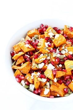 Roasted Sweet Potato Pomegranate Salad Recipe on twopeasandtheripod.com. This healthy salad is the perfect holiday side dish!