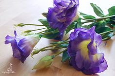 """Purple and Apple Green Eustoma Flower The listing is for TWO stems. Each stem measures approx. 16"""" in length. One stem has 1 flower and 2 buds, the other stem has 3 flowers and 3 buds. Flowers measure approx. 2 – 3 1/4"""" in width. Buds measure approx. 1 – 1 1/2"""" in length. ** This eustoma can be ordered WITH or WITHOUT the stem.  {Perfect for} - bridal headpiece, flower crown, bouquet, corsage and boutonniere - hair piece and millinery hat making - gift packaging - wedding, anniversa..."""