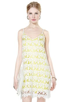Sun showers here we come! Soak up all the rays in this crochet white dress featuring bright yello...