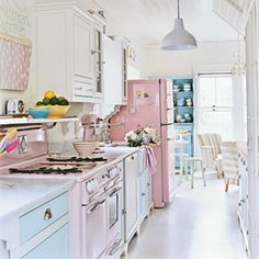 shabby chic kitchens | We love this pastel colored, shabby chic kitchen. White painted floors ...