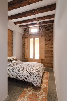 Contemporary flat in Barcelona's Eixample defined by the Catalan hydraulic cement tiles and exposed brick walls and the wooden beamed ceilings - CAANdesign Hotel Room Design, Interior Design Living Room, Tile Bedroom, Bedroom Decor, Ceiling Beams, Beamed Ceilings, Style Loft, Exposed Brick Walls, Simple House