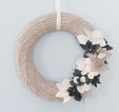 A simple sweater-wrapped wreath:   30 Easy And Cuddly DIY Ideas For Recycling Old Sweaters