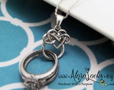 A Sterling Silver clasp large enough to securely hold your wedding rings, is accented by a sterling silver claddagh charm. The clasp will hold a ring with a maximum width of 5/16. The entire pendant measures aprox 1 long.  You can purchase alternate sizes and styles of chains with this link: https://www.etsy.com/shop/AloraLocks?section_id=11015829 Think about how many times a day you might need to remove your ring, only to worry about where you left it. Most women take their rings off to…