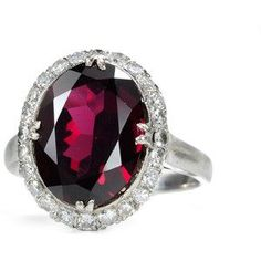 Oval Rhodolite Garnet Surrounded with Diamonds Silver Ring