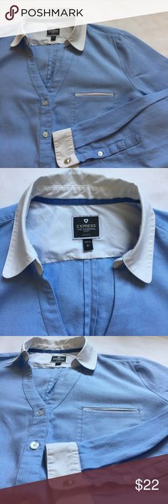 """Express •The Essential Shirt• A must have wardrobe staple! Great used condition button down top from express. Front pocket has a trendy """"sleepwear"""" look to it. The front cut is very flattering for a button down, combines a traditional collar with a feminine V Neck cut! Soft blue and white pinstripe fabric, almost creates a chambray look! Can be dressed up or down! A classic! No flaws. Express Tops Button Down Shirts"""