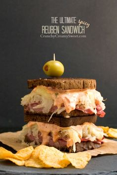 The Ultimate Spicy Reuben Sandwich - the ultimate man food. Layers of corned beef, sauerkraut, Swiss cheese and spicy sandwich sauce enclosed in dark rye slices of bread. You need this in your life! #makethatsandwich