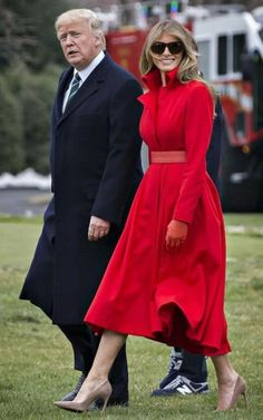 She stood out from her navy-blue clad boys in a stunning red coat dress designed for her by Alice Roi that was cinched with an equally gorgeous red leather belt and gloves by the same designer.