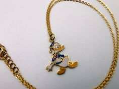 Donald Duck Vintage Metal Pendant Necklace Walt Disney Productions Cloisonne Style NEW old stock by VintageToysForAll on Etsy Kids Jewelry, Unique Jewelry, Necklace Chain Lengths, Vintage Metal, Vintage Children, Happy Shopping, Donald Duck, Walt Disney, Pendants