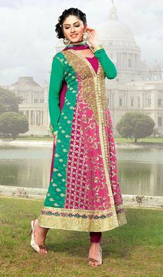Pink and Green Embroidered Georgette Anarkali Suit Look scintillating like a poets rapture dressed in this pink and green shade faux georgette Anarkali suit. Kameez is adorned with gota work, sequins and embroidered foliage patterns all over. Contrasting hemline with foliage patterns adds to the beauty of the attire. #EmbroideredAnarkaliSuit #BridalChuridarSuitDesigns