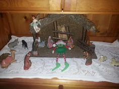 Keeping baby Jesus's bed warm. 😇