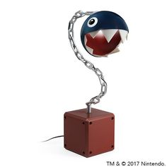This Super Mario Chain Chomp Lamp is perfect for lighting up your workspace so you can ask for that raise or just finish your homework. This task light has the Chain Chomp's head on a swivel so that you can direct the beam just where you need it.