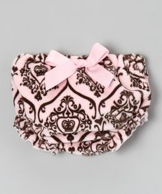 A darling bow and ruffled accents keep tiny tushies preciously covered, while an elastic waistband and leg openings ensure that this pair of velour bloomers keeps sweeties as comfy as they are adorable.100% polyesterMachine wash; tumble dryMade in the USA